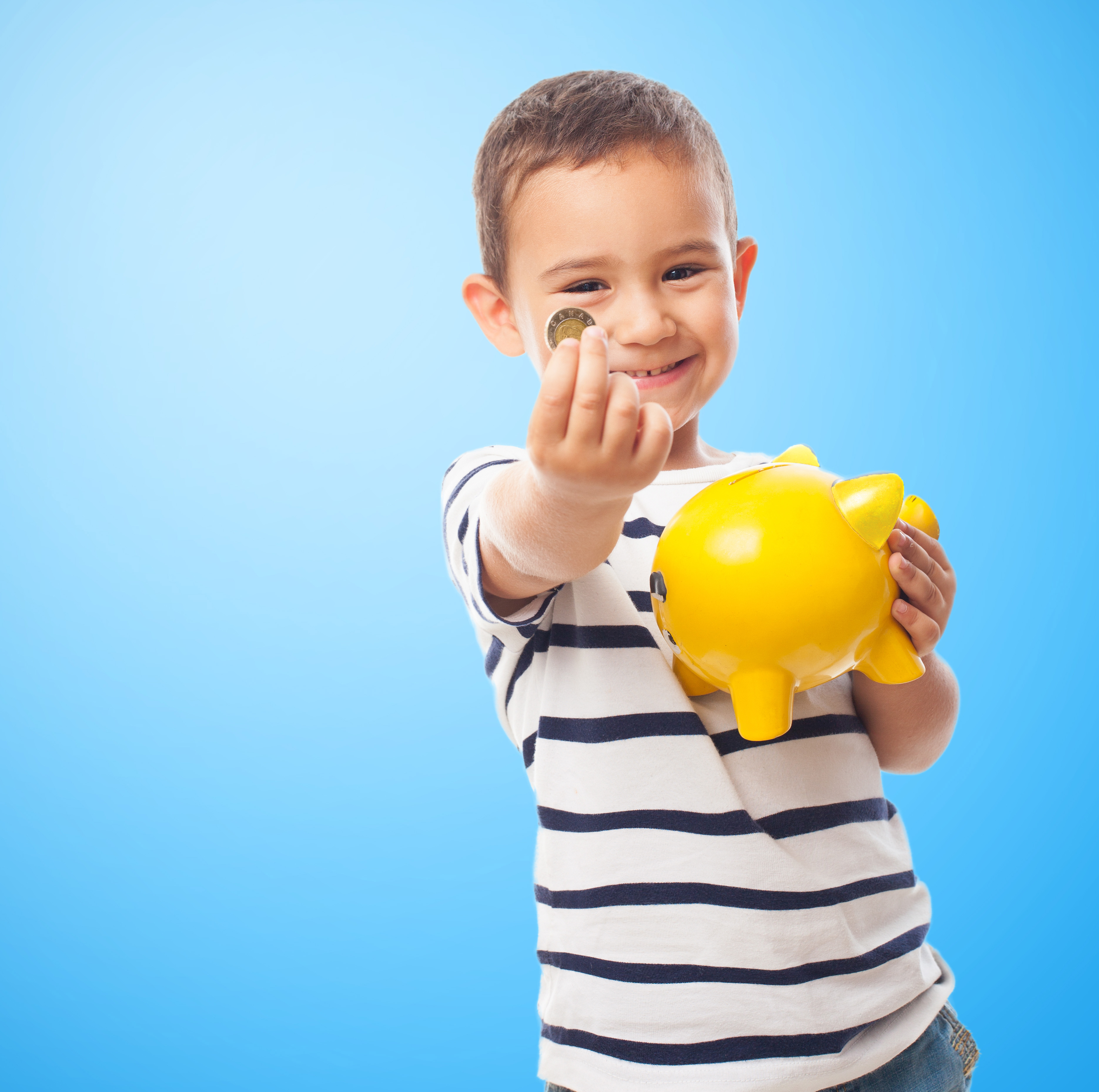 boy with yellow piggy bank